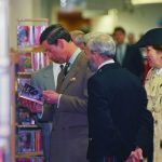 Prince Charles reading a Harlequin Mills & Boon title