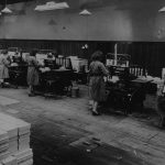 Employees working in the Nelson and Sons bindery.