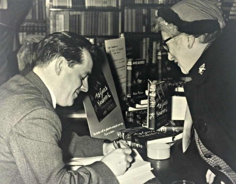Alistair MacLean signing books