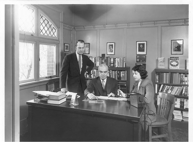 A planning meeting at Collins Canada, circa 1940s